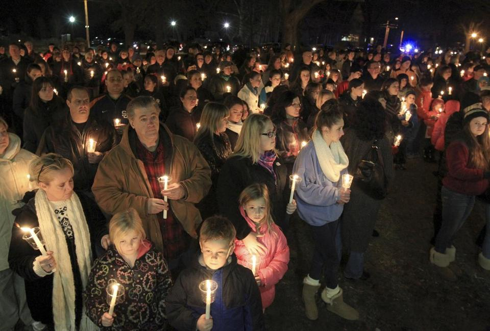 Hundreds of people turned out on Franklin Common for a vigil to remember Lexi Munroe, 8, and Sean Allan Munroe II, 7, who suffocated after they became trapped inside a hope chest in their home Sunday.