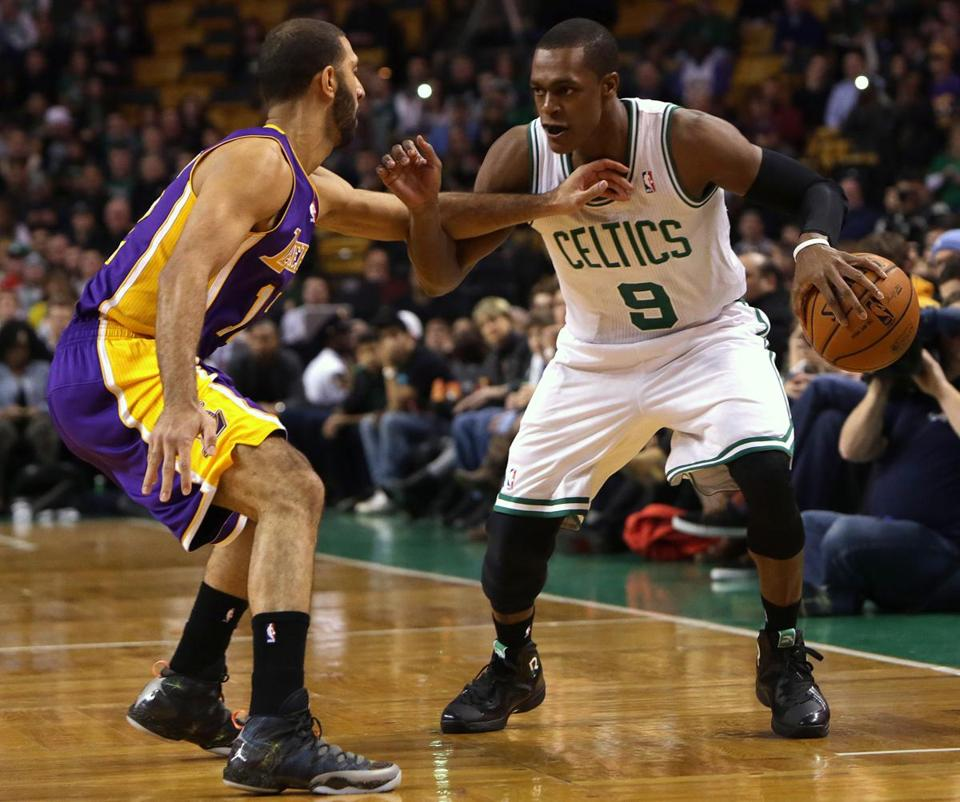 Rajon Rondo drove around Lakers point guard Kendall Marshall on Friday at TD Garden in his first game in nearly a year.