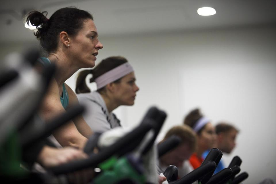 Dedicated fitness buffs powered through a spin class at Flywheel Sports, which is among the specialized studios thundering into Boston.