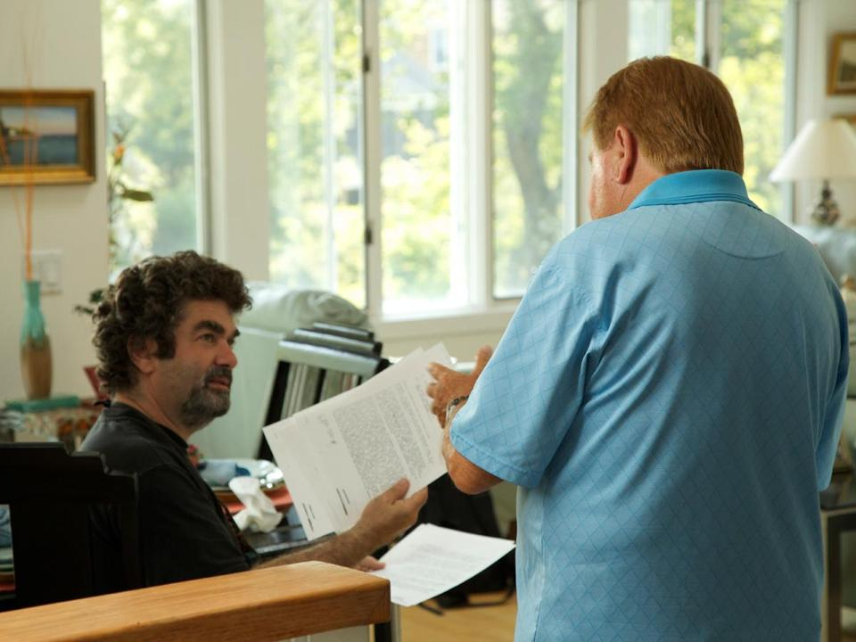 "Director Joe Berlinger (left) reviewed documents with ex-FBI agent Robert J. Fitzpatrick for the movie ""Whitey."""