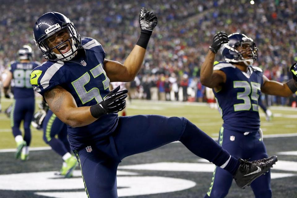 The Seahawks' Malcolm Smith celebrates after hauling in the game-clinching interception in the end zone with 22 seconds left.