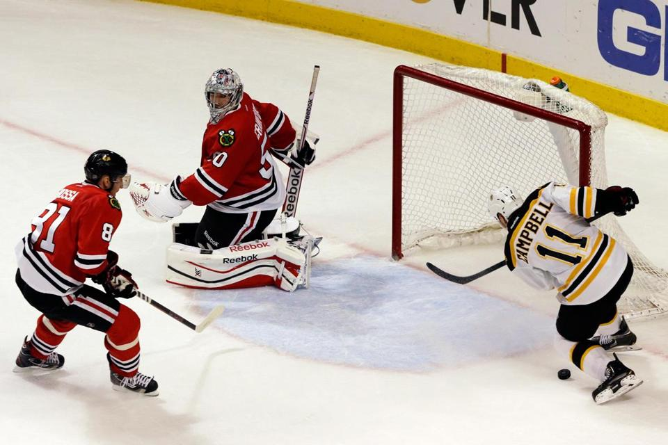 The Bruins' Gregory Campbell is handed a wide-open net to shoot at in overtime, but can't get his stick on the puck to beat goalie Corey Crawford and the Blackhawks.