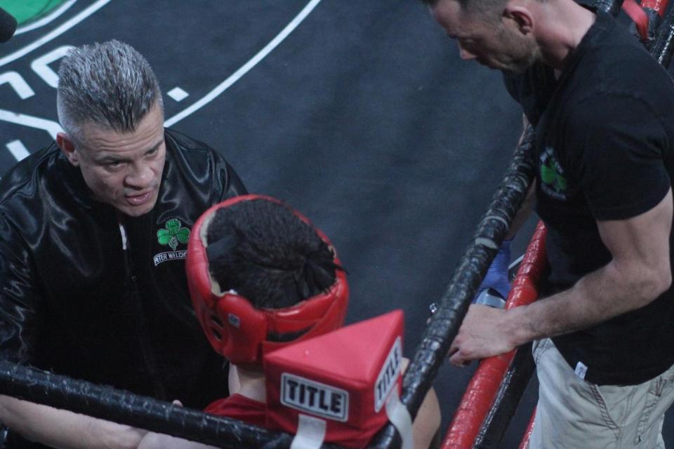 "Peter Welch (left) talks between rounds with boxer Matt Phinney in the new Discovery show ""The Fighters."""