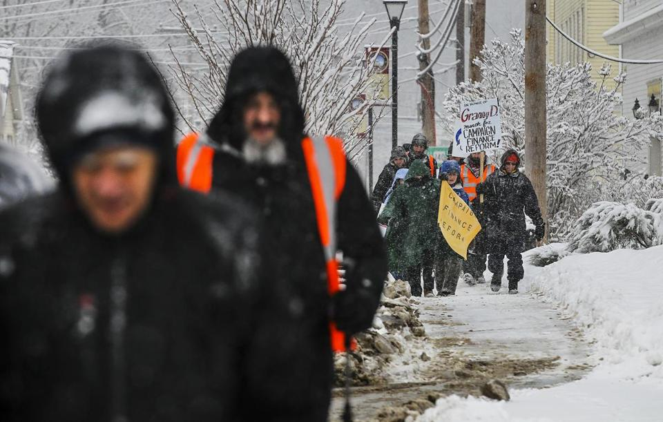 NH Rebellion walk participants plodded their way up Main Street in Belmont, N.H., on Sunday. The two-week walk wraps up Friday.