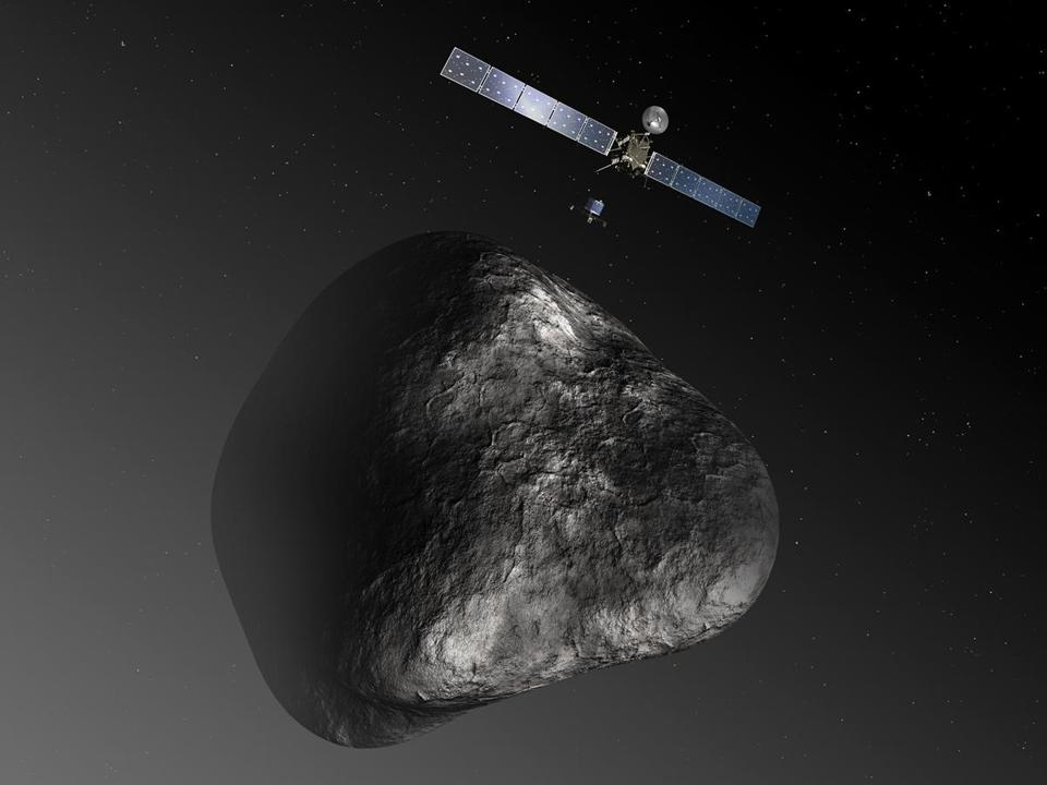 An artist's impression shows the Rosetta orbiter deploying a lander to comet 67P/Churyumov–Gerasimenko. A landing on the comet is scheduled for November.