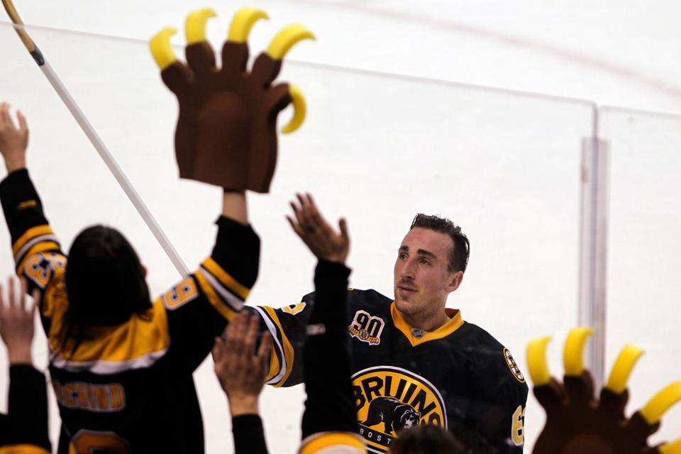 Brad Marchand gives away his stick — which had two goals in it — after being named first star of Monday's game.