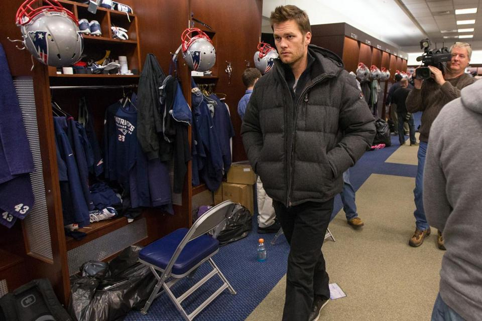 Tom Brady walked past the media without speaking on Monday in the locker room at Gillette.