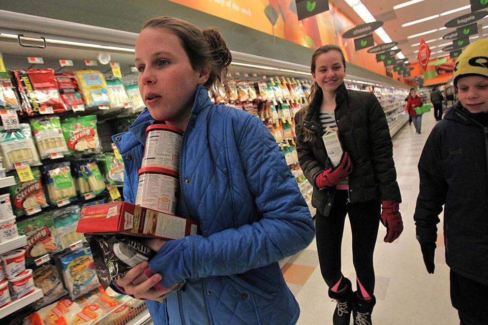 Sarah McEachern, her friend, Kristen Miquel, and her brother, John, bought baking supplies on their snow day.