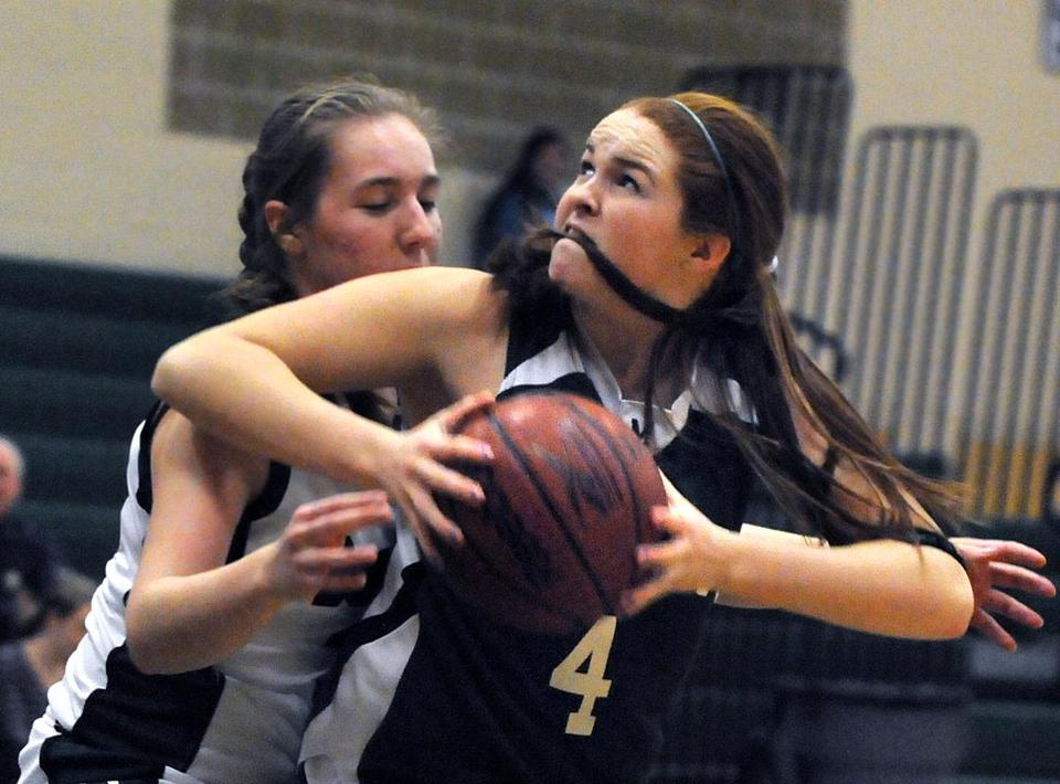 Mansfield High School's Janet Maher looks to fire up a shot against Canton High player Eileen Khoury in the first half of their  game Tuesday; visiting Mansfield won 61-35, lifting the Hornets to 8-2 on the season.