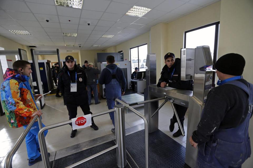 Security guards checked visitors at the entrance to the Olympic park in Adler near Sochi last week. In light of recent threats, President Vladimir Putin has said Russian security officials are prepared for the start of the Games on Feb. 7.