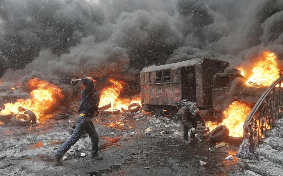 Protesters threw rocks at police on Wednesday during increasingly violent demonstrations in the Ukraine capital of Kiev.