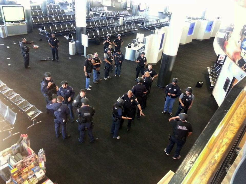 Officers investigated the shooting scene at Los Angeles International Airport's Terminal 3 in November.