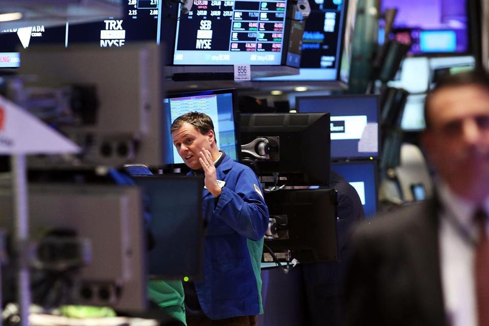 Traders worked the floor of the New York Stock Exchange Friday.