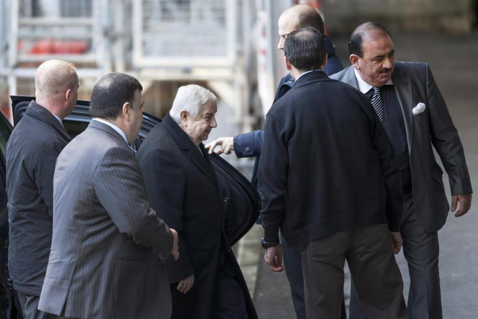 Syrian Foreign Minister Walid al Mouallem (center) arrived Friday for start of negotiations at the European headquarters of the UN in Geneva.