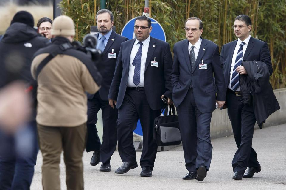 Syrian opposition chief negotiator Hadi Bahra, 2nd right, arrived with representatives of main the political opposition group at the United Nations, in Geneva, Switzerland.