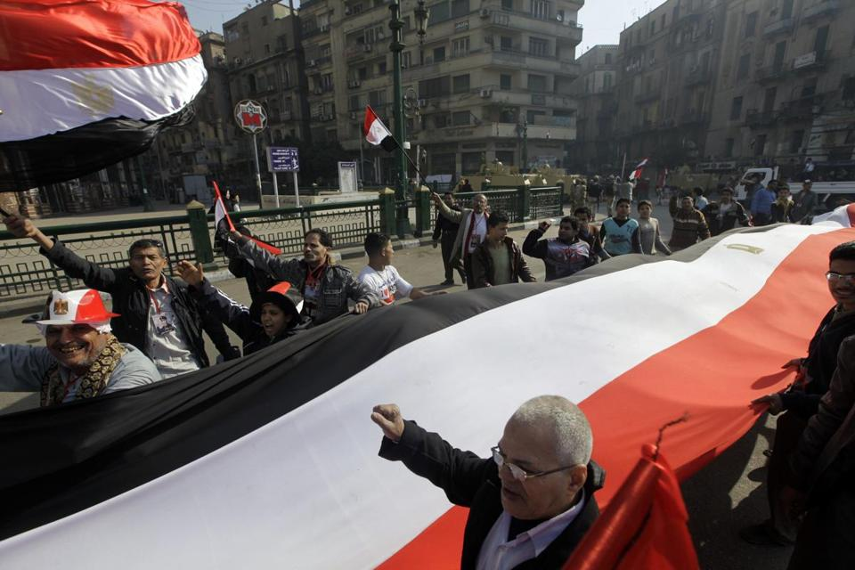 Egyptians carried a giant banner during a rally in Cairo's Tahrir Square on Saturday.
