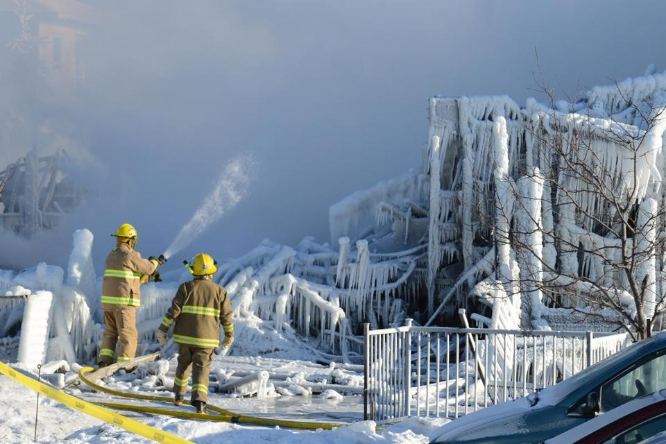 Quebec firefighters struggled with frigid temperatures to search for elderly people still missing in a L'Isle-Verte fire.