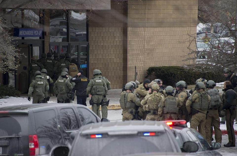 Police enter the Sears department store at the Columbia Mall after a fatal shooting.