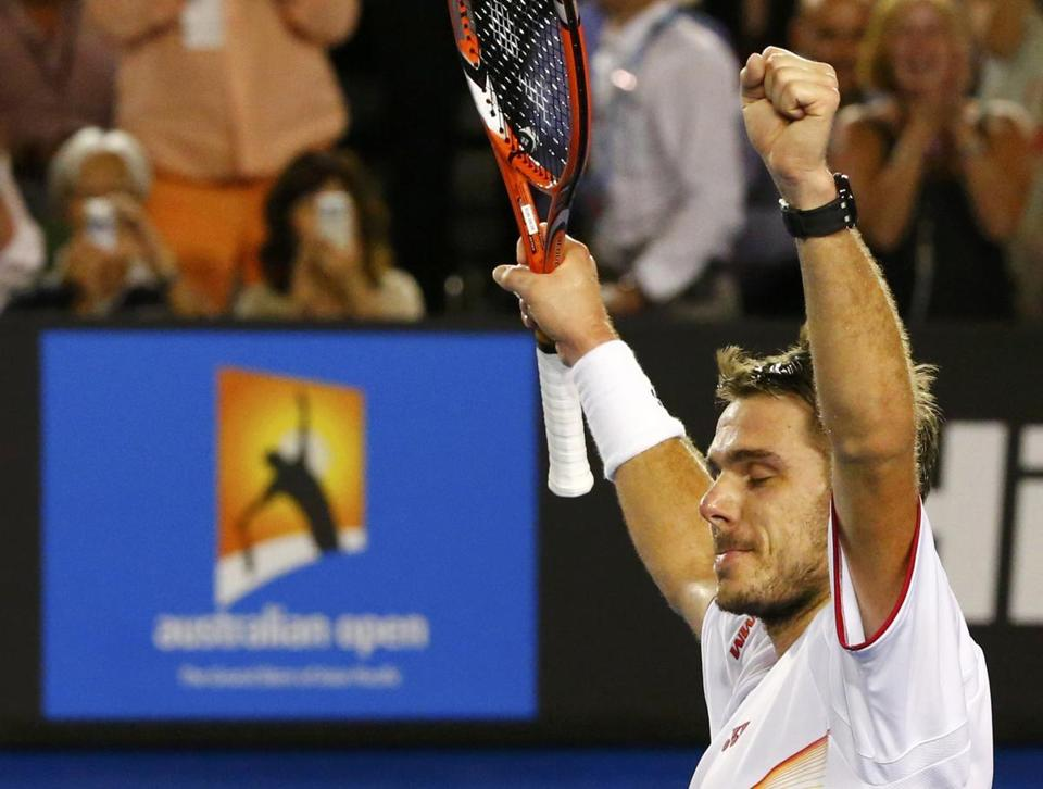 Stanislas Wawrinka raised his arms in celebration after defeating Rafael Nadal to capture the men's singles title at the Australian Open on Sunday.
