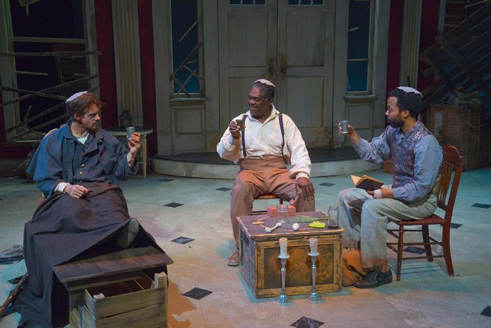 From left: Jesse Hinson plays a wounded Confederate soldier; Johnny Lee Davenport and Keith Mascoll play his former slaves.