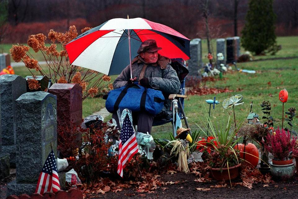 Rocky Abalsamo — shown at the grave of his wife, Julia, on Nov. 26, 2000 — died on Jan. 22 at age 97. For many years after his wife of 55 years died in 1993, he spent every day by her side at St. Joseph Cemetery in West Roxbury.