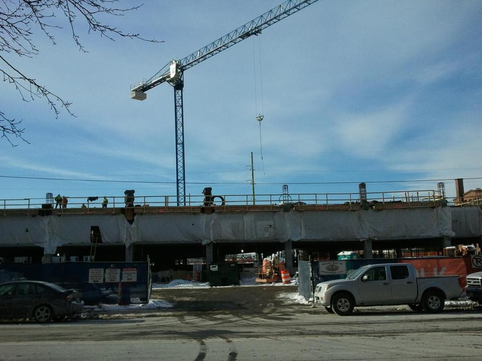 Construction continued last week at the MBTA's new parking garage in Beverly.