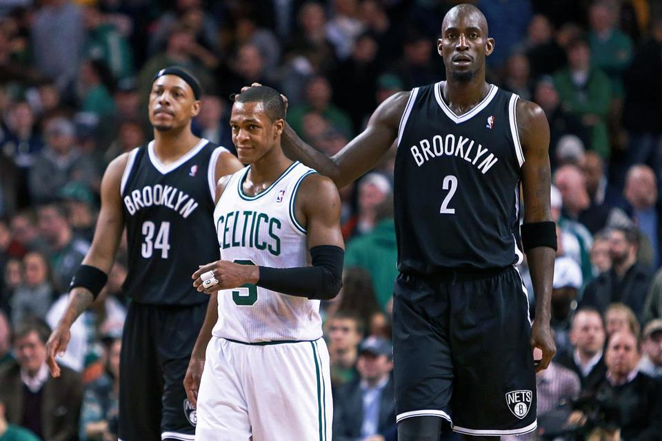 In the final seconds of Brooklyn's victory, Kevin Garnett pats the head of former teammate Rajon Rondo. Another ex-Rondo teammate and current Net, Paul Pierce, is at left.