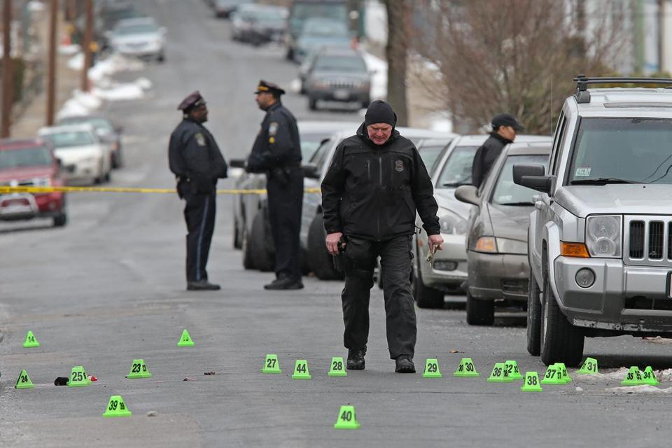 Police investigated the scene on Rosewood Street in Mattapan, where a man and woman were shot to death Monday.