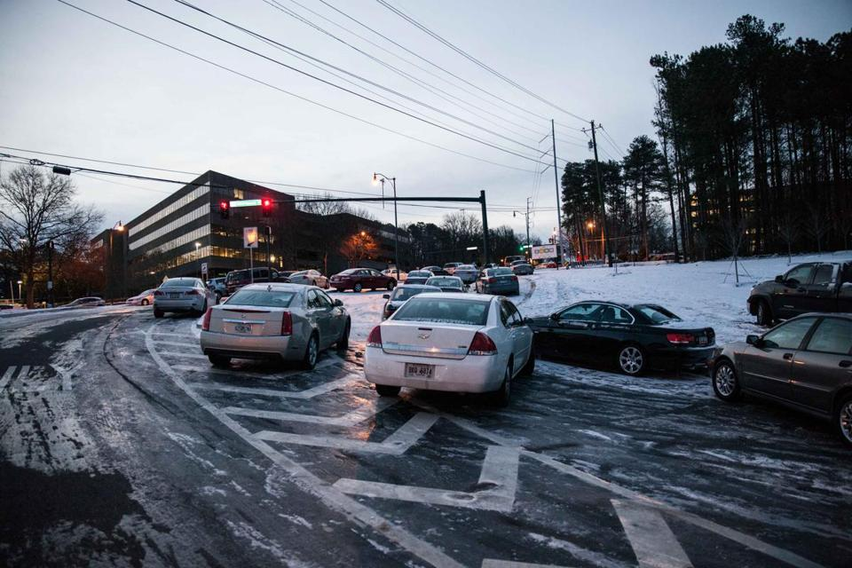 Vehicles were abandoned Tuesday evening on an off ramp in Dunwoody, Ga.