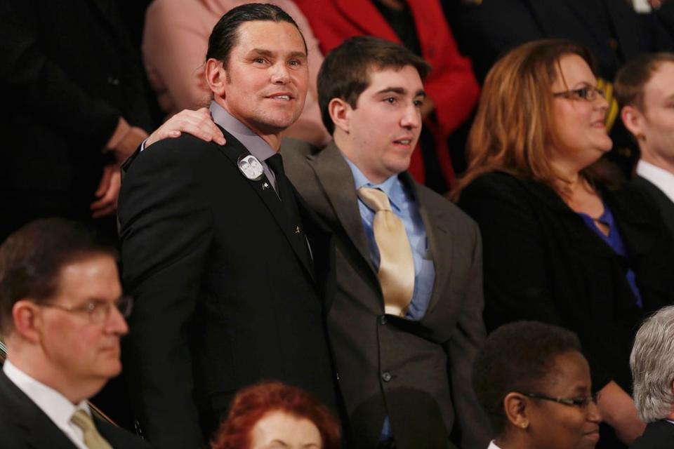 Carlos Arredondo and Jeff Bauman at the speech Tuesday. The pair have become close since the Marathon bombing.