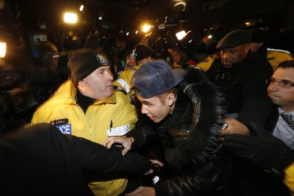 Pop singer Justin Bieber arrived at a police station in Toronto on Wednesday. Bieber was mobbed by screaming fans and journalists.