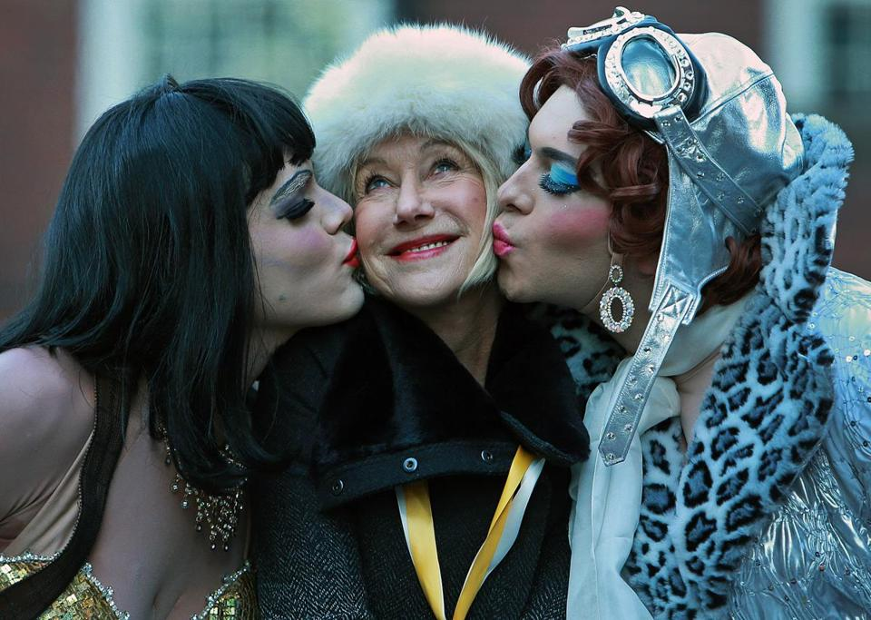 Helen Mirren rode through the streets of Cambridge during the Hasty Pudding parade and received the traditional dual kiss on the cheek from Tony Oblen (left), president of the hasty pudding, and Ethan Hardy, cast vice president.