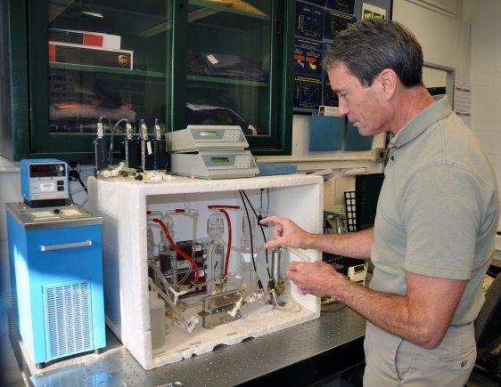 Researcher Phil Gibson demonstrates a humidity-testing device that he used on material for Burton's outerwear.