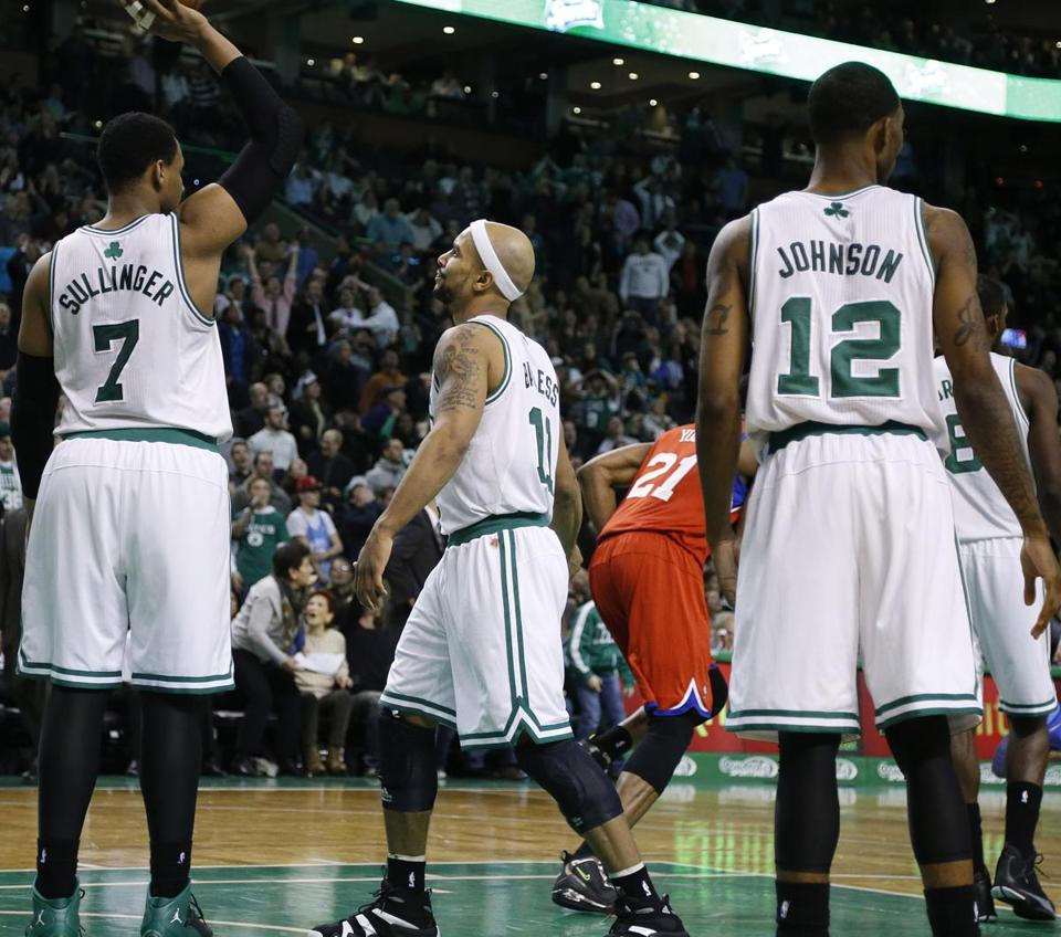 Jared Sullinger, Jerryd Bayless, and Chris Johnson were dejected after the buzzer-beater.