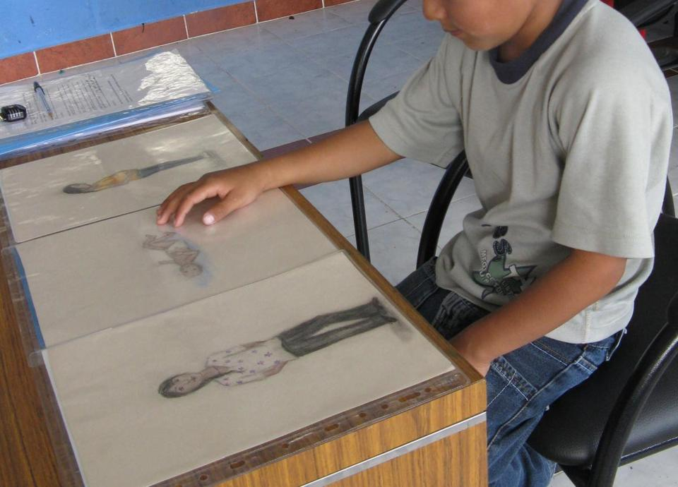 A child in the study in Ecuador examined three images researchers used to help children visualize the time before and after they were born.  All the children studied showed belief that they had existed in some way before conception.