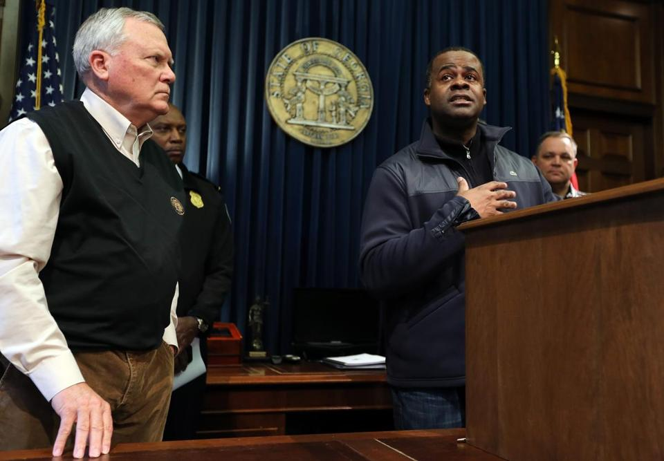 Atlanta Mayor Kasim Reed responded to a question Wednesday about the city's response to this week's snowstorm. Georgia Governor Nathan Deal (left) looked on.