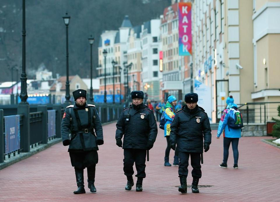 SOCHI, RUSSIA - JANUARY 31: Police security patrol the Rosa Khutor Mountain Cluster village ahead of the Sochi 2014 Winter Olympics on January 31, 2014 in Rosa Khutor, Sochi. (Photo by Getty Images/Getty Images)