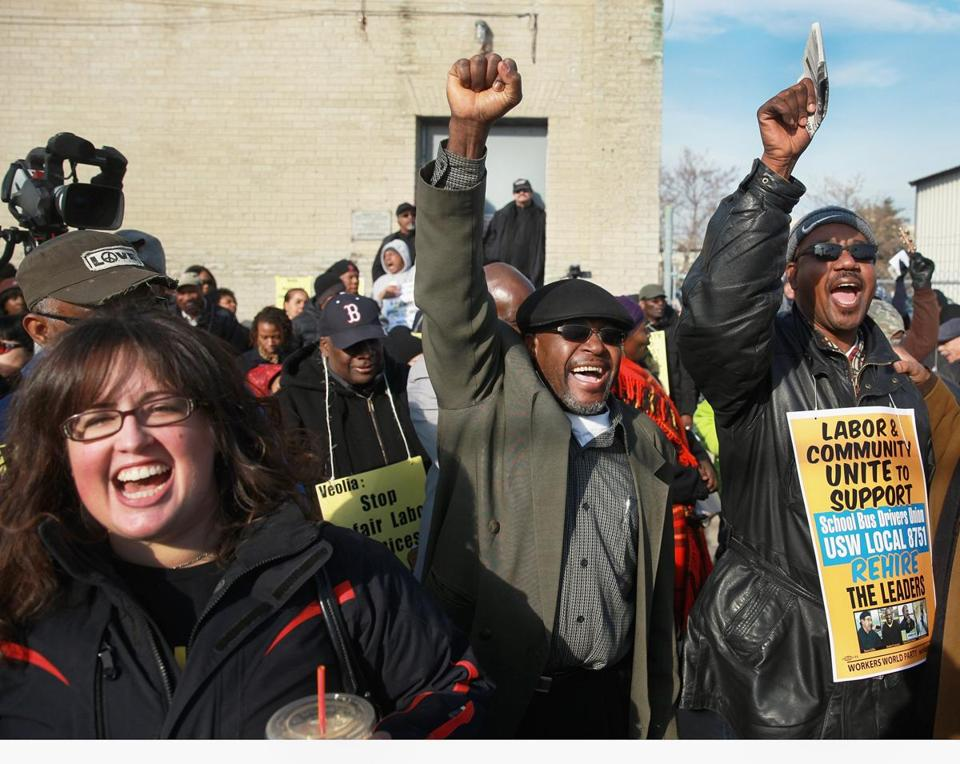 Supporters of four fired Boston school bus drivers rallied in Dorchester, calling for Veolia Corp. to reinstate them.