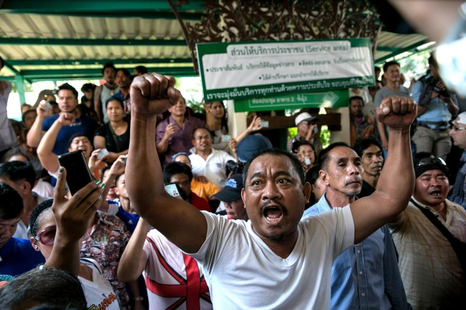 Angry residents yelled at police as general election polling stations were blocked by protesters in Bangkok.