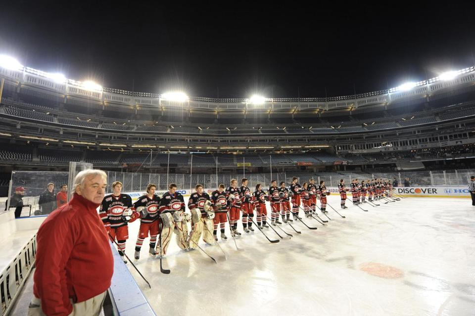 Catholic Memorial coach Bill Hanson listens as his players are introduced at Yankee Stadium prior to the Knights' game with Delbarton. CM lost to the New Jersey school, 3-0.