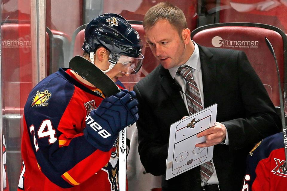 In the span of two years, John Madden (right) has gone from NHL player to assistant coach.