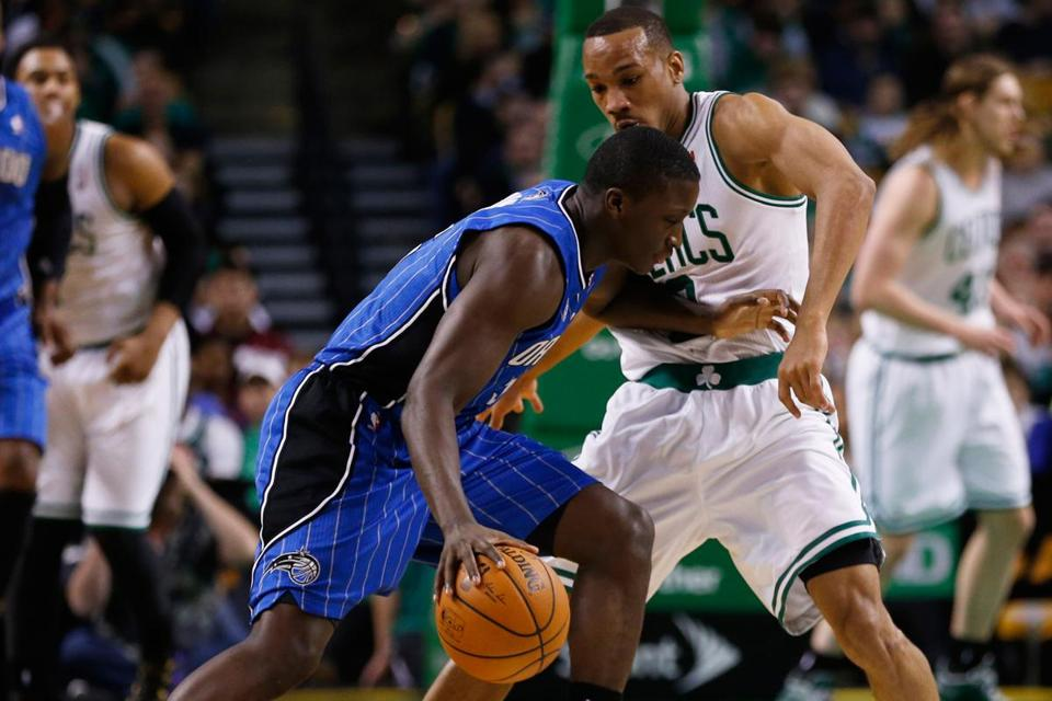Avery Bradley, in his return from a five-game absence, pressures Orlando's Victor Oladipo.