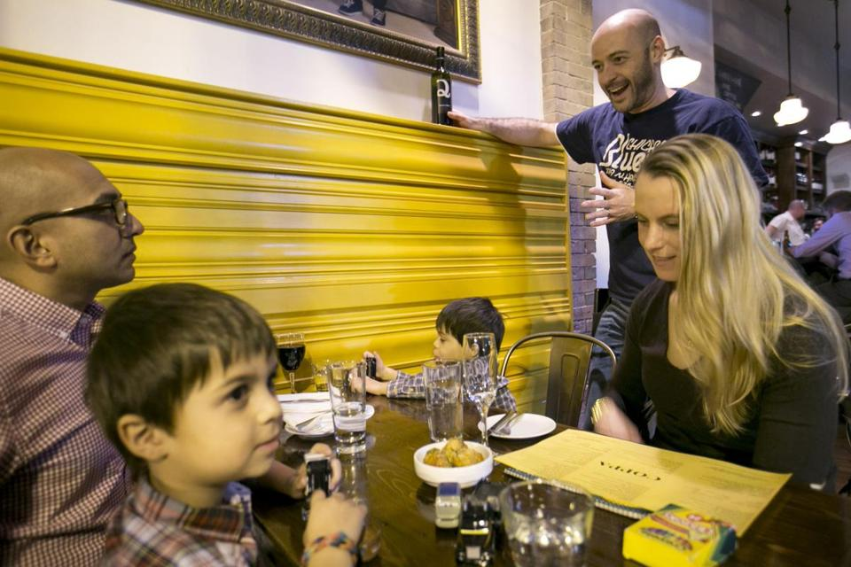 Jesse Weiss waits on Alexandra Patel and her children, Noah and Devin, at Coppa.