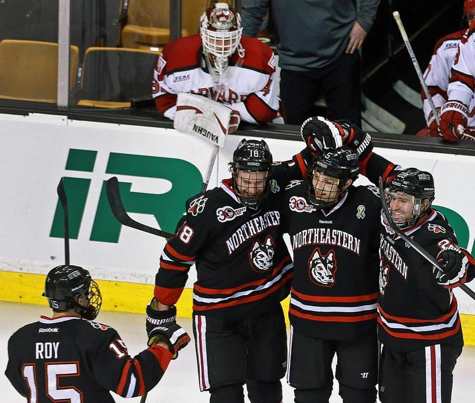 Harvard's starting golie Raphael Girard could only watch after being pulled and Northeastern went on to add to its lead.