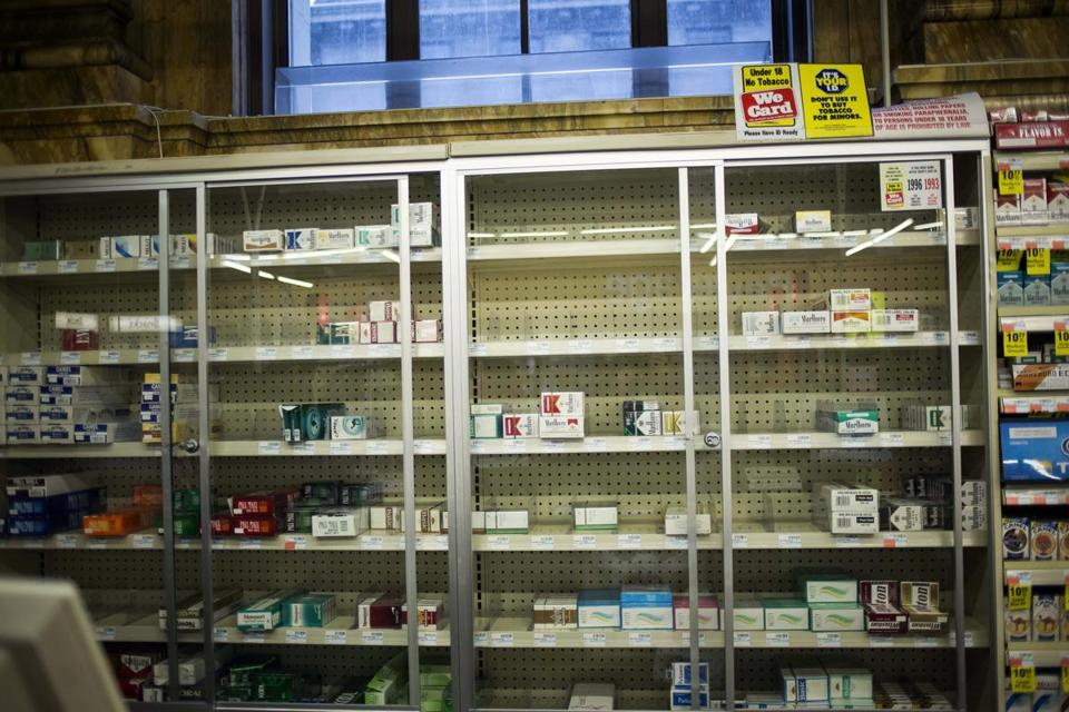 Near empty cigarette shelves are seen at a CVS store in New York.