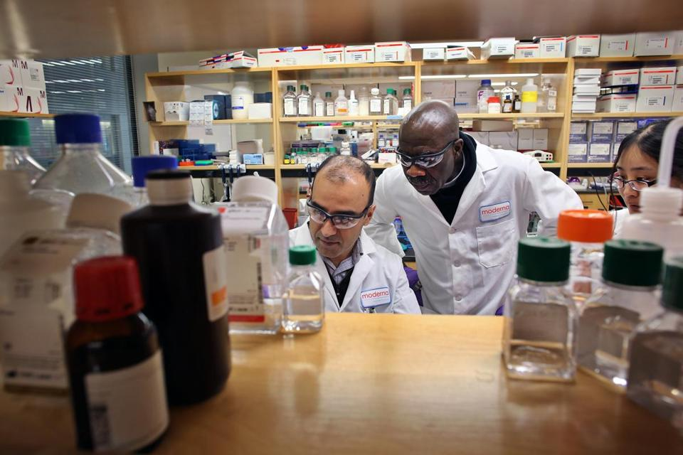 Kambiz Mousave (left), Frank Kwame Manu, and Judy Cheng worked on messanger RNA at Moderna in Cambridge.