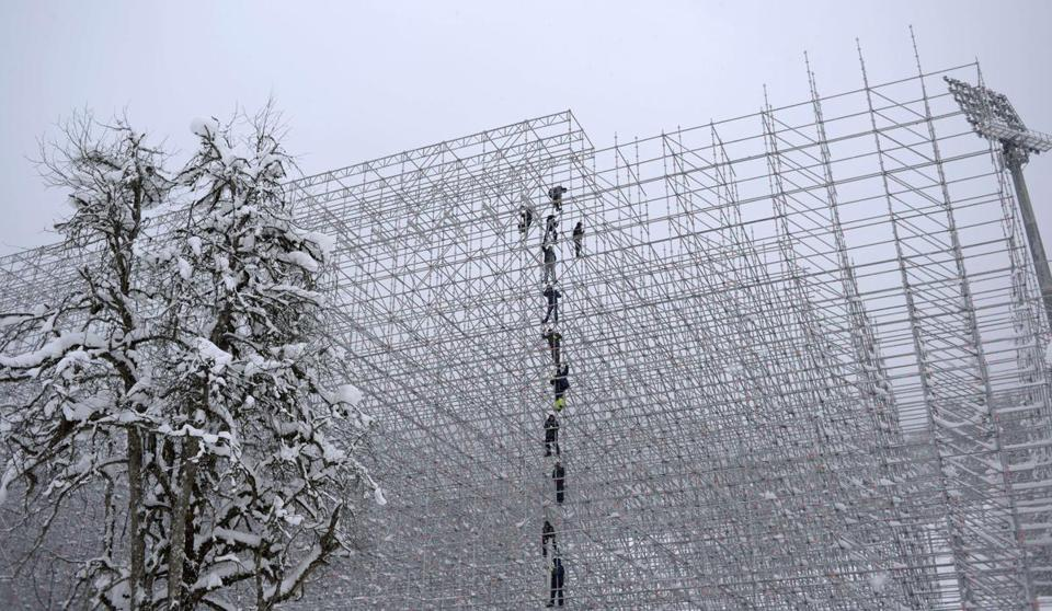 Workers construct spectator stands in December in Krasnaya Polyana, where snow events will be held.