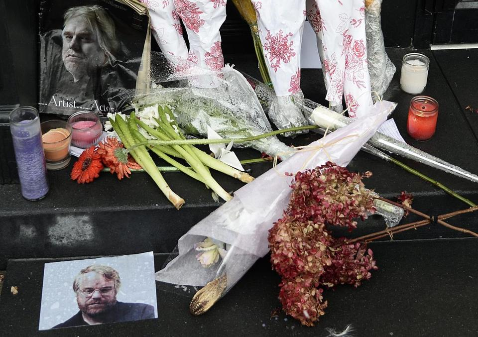 A makeshift memorial with photos and flowers was set up outside the New York City apartment building where the body of Philip Seymour Hoffman was found.
