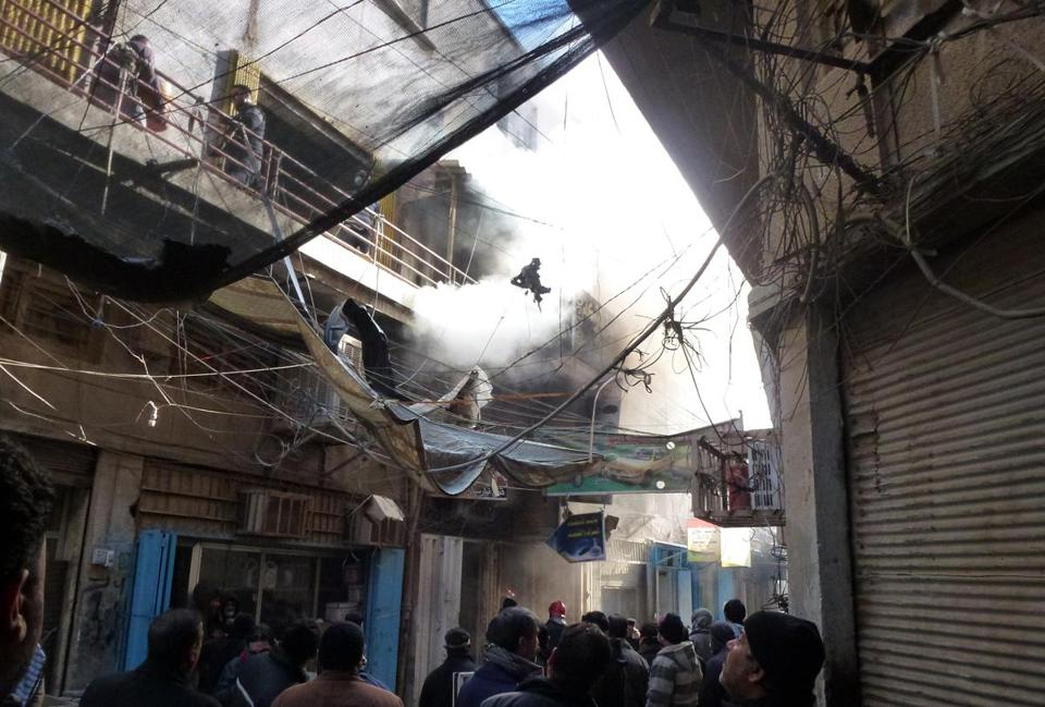 Smoke billowed from the first floor of a building damaged by a car bomb in central Baghdad on Wednesday.