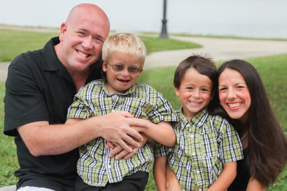 Shawn and April Wilmar with their sons, John, 9, (left) and Ryan, 6. John has a rare genetic disease but, thanks to his parents' perseverance enjoys an active, full life.